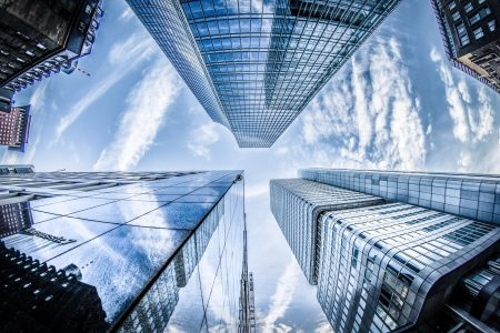 low-angle-photo-of-four-high-rise-curtain-wall-buildings-830891 (1)